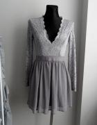Fioletowa sukienka z koronką rozkloszowana NLY Trend...