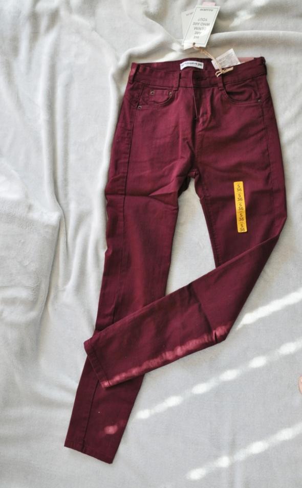 bordowe spodnie push up rozmiar S...