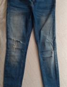 jeansy z dziurami Mohito