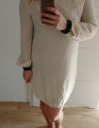 Sukienka że skórzanymi wykończeniami...