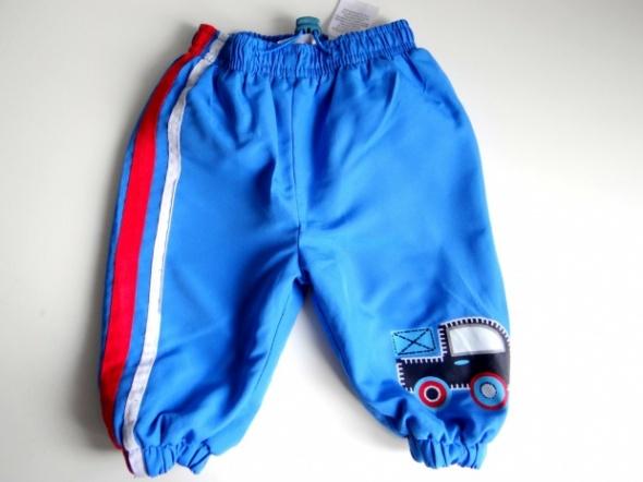 Ciepłe spodnie z polarem rozmiar 68