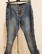 Spodnie jeans wiązane...