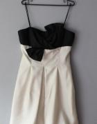 Biała sukienak kokarda...