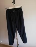 Granatowe eleganckie spodnie reserved...