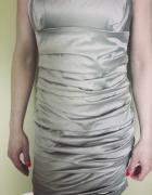 Elegancka dopasowana sukienka...