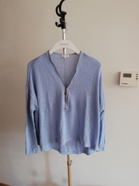 Asymetryczny sweter zip...