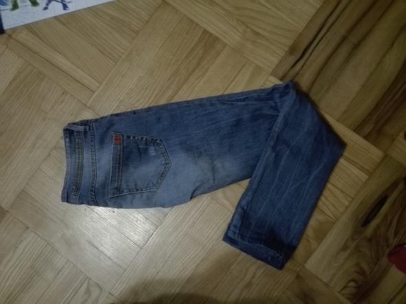 Spodnie jeansy Mango...
