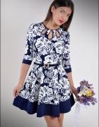Urocza sukienka rozkloszowana wzory L 40