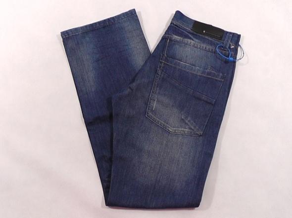 QUTFITTERS NATION spodnie męskie W31 L32 pas 76 cm