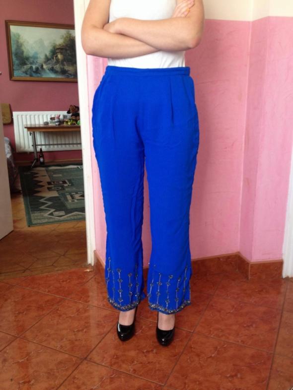 Spodnie Bollywood spodnie z dżetami XS S 34 36 niebieskie cekiny szafirowe unikatowe belly dance taniec brzucha granatowe dżety ozdoby