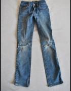 Jeansy z dziurami na kolanach H&Mdla dziewczynki 140...