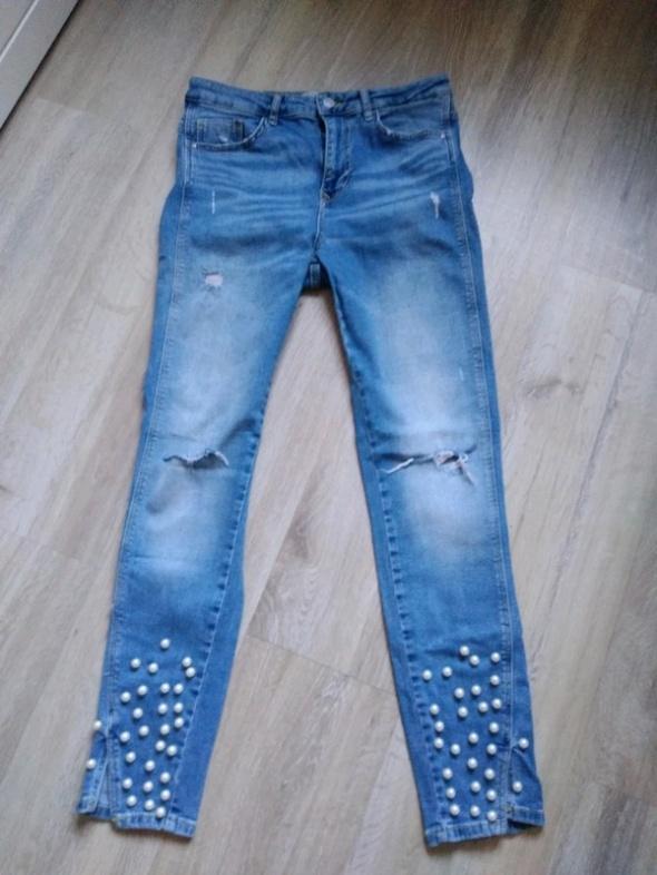 Spodnie jeansowe perły...