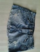 Mini spódniczki jeans przetarcia dziury Diesel...