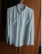 Biała elegancka koszula...