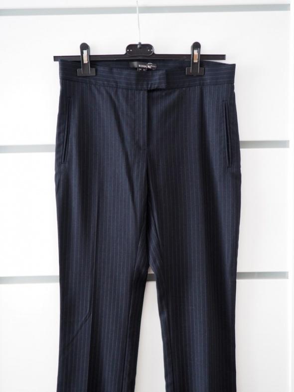 Eleganckie spodnie marki Mango 34...
