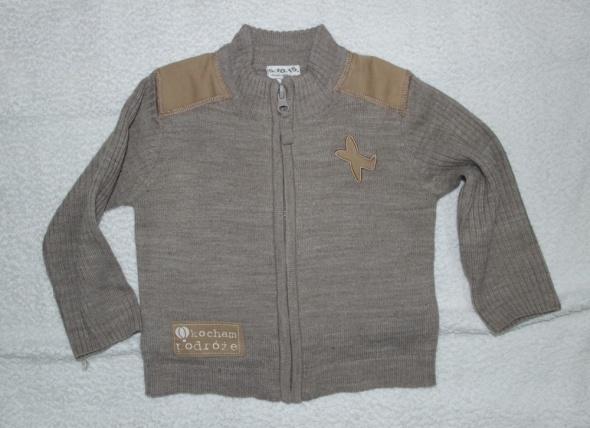 Beżowy sweterek 80