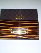 Nowy skórzany portfel brązowy lakierek...