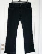 Oryginalne czarne jeansy Orsay bootcut...