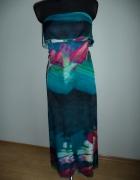 Długa sukienka kolorowa z falbanką...