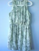 Atmosphere miętowa rozkloszowana sukienka mgiełka...