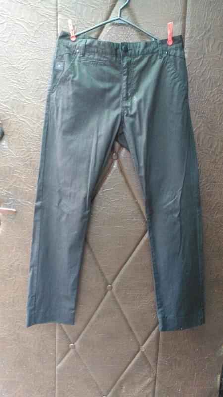 Eleganckie męskie spodnie w prążki House nowe...