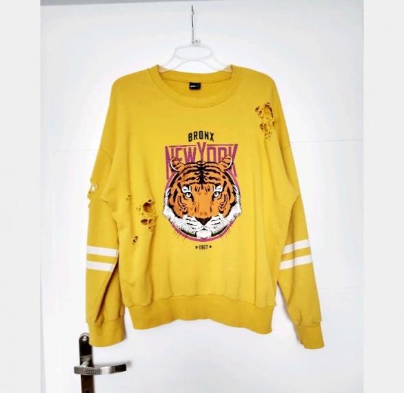 Stylowa żółta bluza z dziurami Gina Tricot