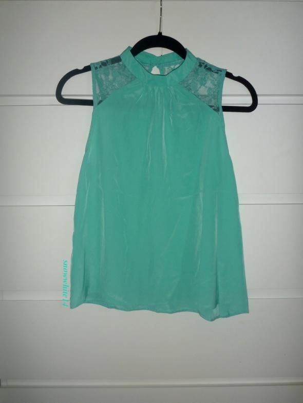 Bluzki śliczna miętowa bluzeczka z koronką