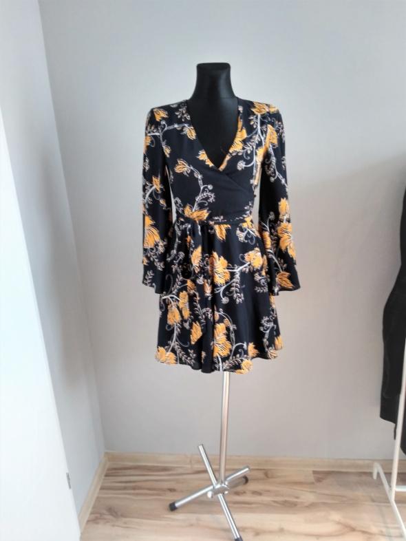 Piękna sukienka w kwiaty Bik Bok