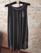 Czarna sukienka ozdobiona cekinami...