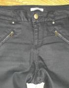 Czarne spodnie rurki Orsay 34...