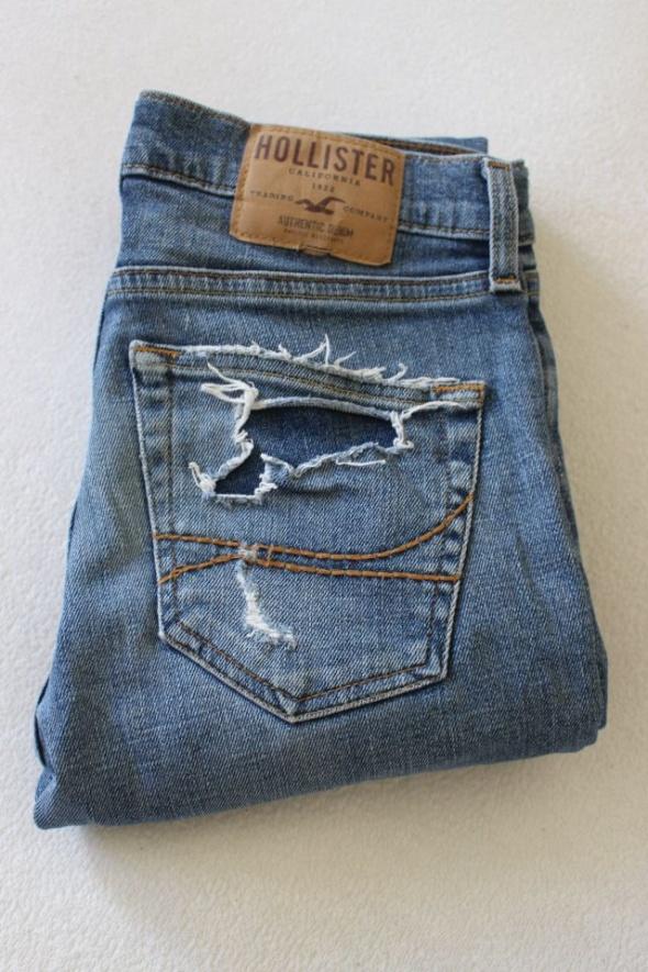 spodnie jeansowe z przetarciami...