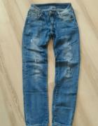 Spodnie jeans biodrówki rurki dziury XS...