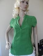 Zielona bluzka marki H&M...