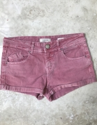 Różowe jeansowe krótkie spodenki szorty...