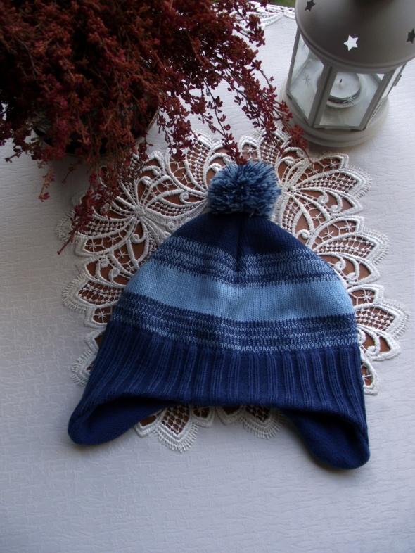 Niebieska czapka uszatka dziecięca w paski z pomponem H&M