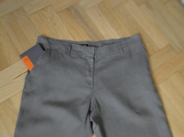 Spodnie khaki H&M 44 len jak nowe
