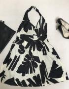 Rozkloszowana sukienka w kwiaty...