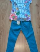 Bluzka z dłuższym tyłem i niebieskie spodnie dziew...