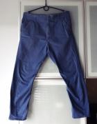Męskie spodnie chinosy cygaretki Next rozmiar M...