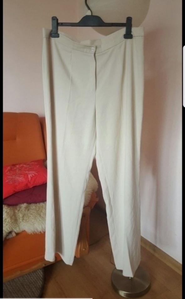 Beżowe szerokie spodnie