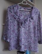 Krótka elegancka bluzka z żabotem 44...