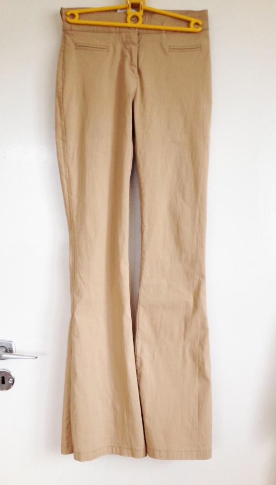 Beżowe spodnie szerokie nogawki Pimkie