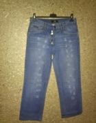 Niebieskie proste jeansy z przetarciami W30 L32...