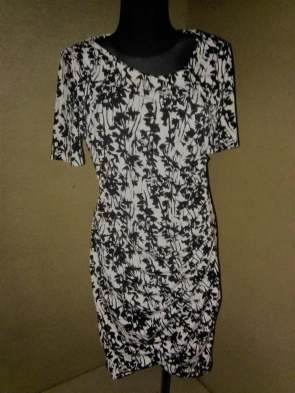 Czarno biała sukienka ołówkowa midi H&M 38