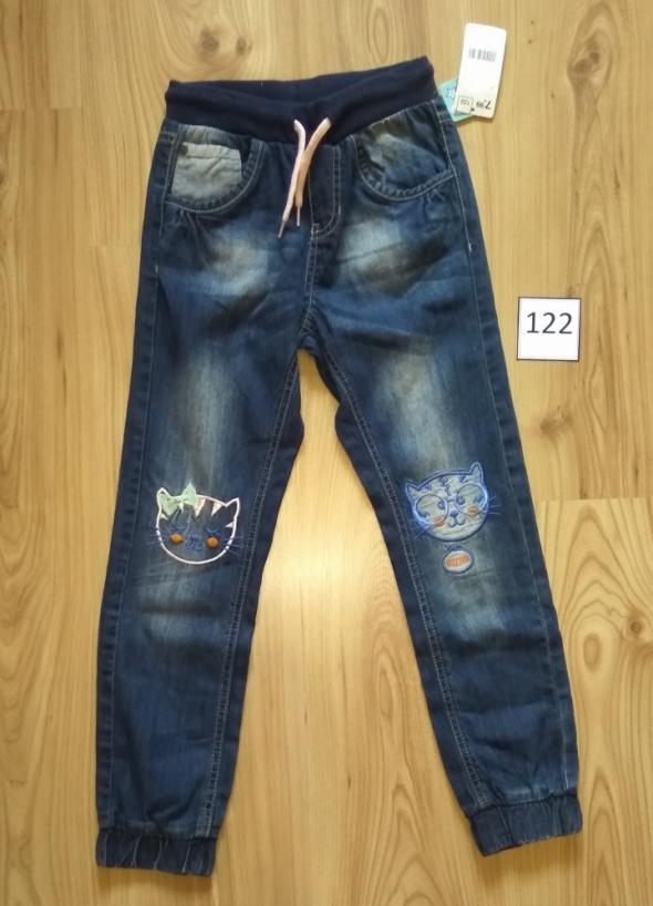 Nowe dziewczęce spodnie joggery jeansowe spodnie kotki na kolanach 122
