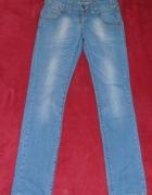 Jeansy niebieskie Cross Flora W 27 L 32...