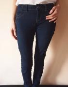 Granatowe spodnie dżinsy rurki Bershka S 36 M 38...