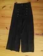 spodnie z lejacego materialu...