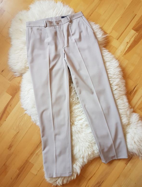 Beżowe spodnie eleganckie Monnari 42...