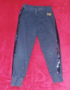 Lindex spodnie brokatowe dziewczęce rozm 122 cekiny...